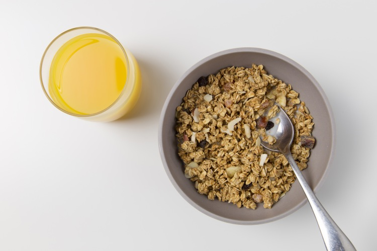 Breeakfast cereal bowl with orange juice